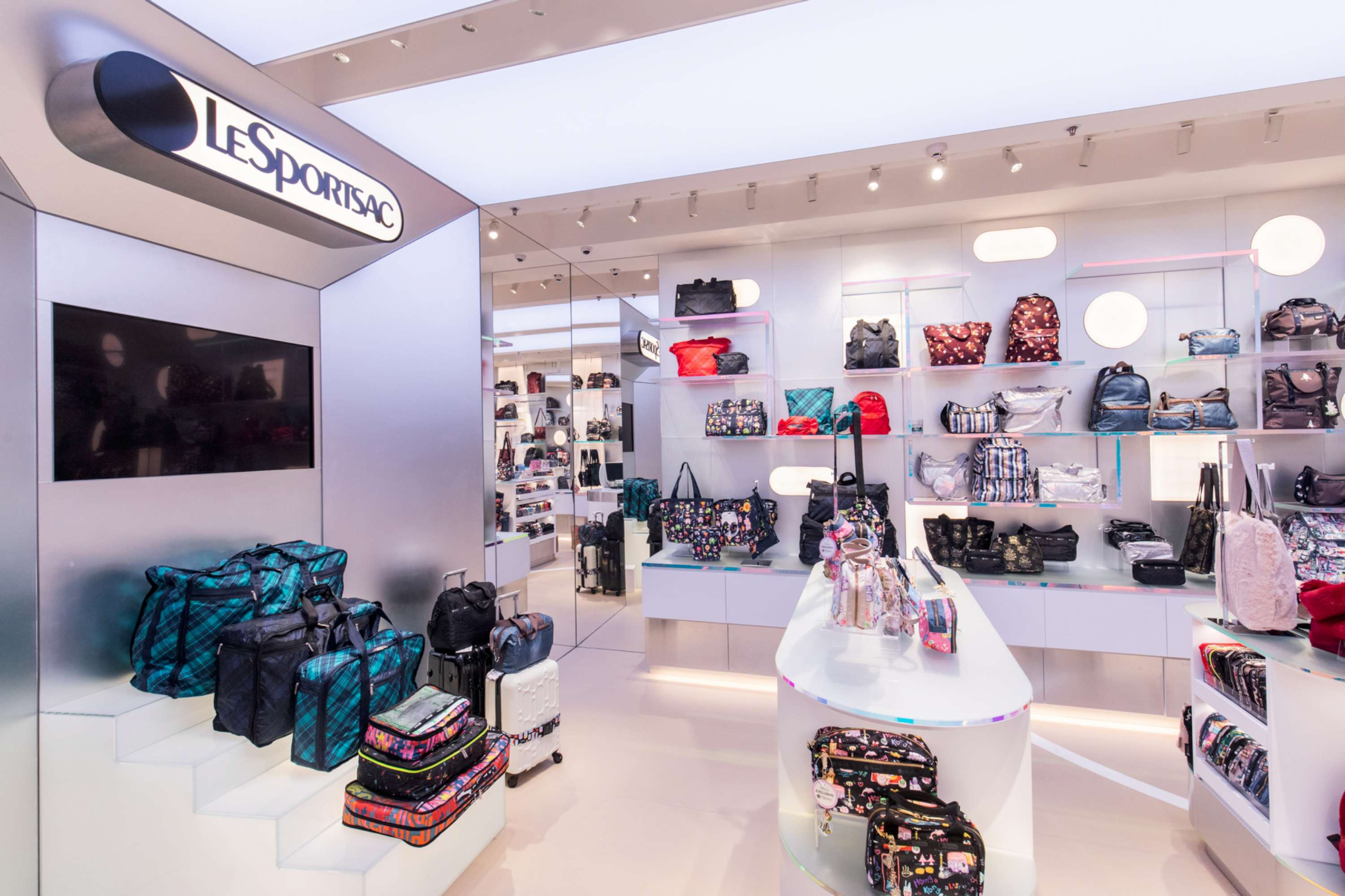 "NEW SHOP IMAGE ""FUTURISTIC GALLERY SPACE""  FOR LESPORTSAC PACIFIC PLACE  DESIGNED BY CLIFTON LEUNG"